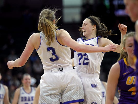 Drake's Caitlin Ingle (22) and Lizzy Wendell (3) celebrate
