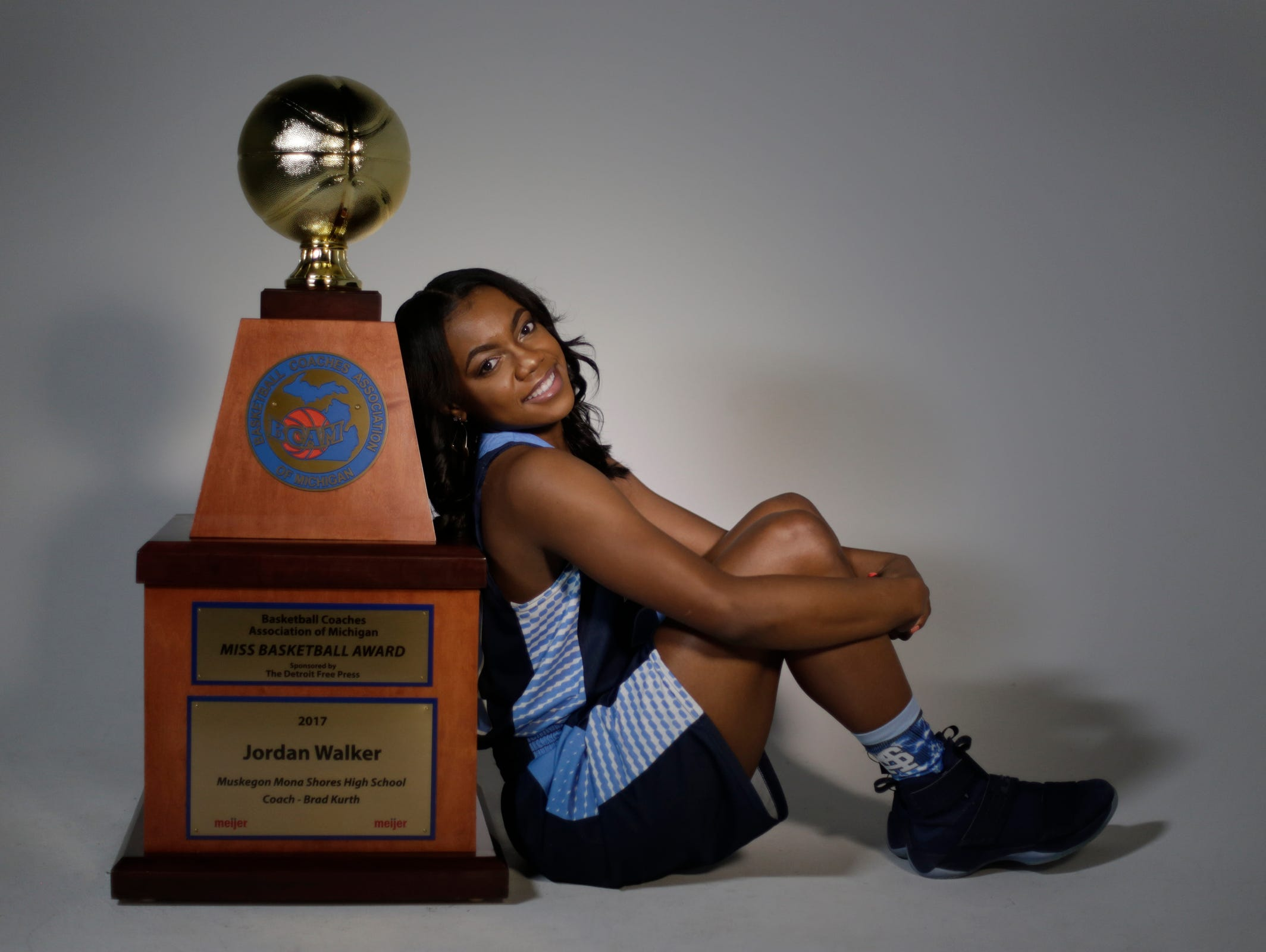 Jordan Walker from Mona Shores High School in Muskegon, was named the 2017 Miss Basketball Monday March 13, 2017. She poses with her trophy at the Detroit Free Press.