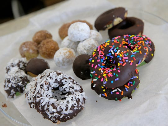 Carmen Petruzzelli, owner of Glenda's Kitchen, displays doughnuts at her business in Middletown.