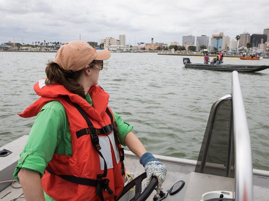 Kelby Broussard looks over to another bout as they practice isolating an oil spill using a boom during Texas A&M University-Corpus Christi National Spill Control School's Oil Spill Response course on Wednesday, March 15, 2017.