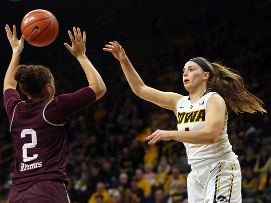 Missouri State's Lexi Hughes steals a pass from Iowa's