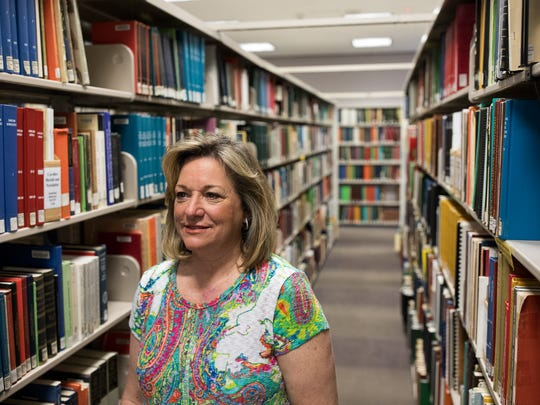 Andi Estes, who is  middle of researching the Murphy family to submit an application to the Texas Historical Commission for a historical marker designation, stands in the local history section of the La Retama Library.
