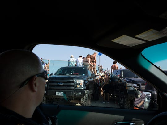 Port Aransas Police Sergeant Olan Kelley patroles the beach during spring break on Thursday, March 17, 2017.