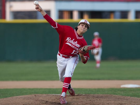 Robstown's Carlos Trevine throws a pitch during the second inning of their game against Sinton at Steve Castro Field in Robstown, on Friday, March 17, 2017.