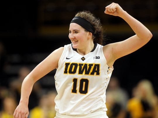 Iowa's Megan Gustafson celebrates the Hawkeyes' WNIT