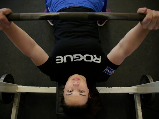 Teen sets bench press record, excels in classroom with