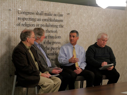 (center) Jack Ciattarelli, Republican candidate for governor, speaks with (L-R) Bob Jordan, Statehouse reporter, Randy Bergman, opinion editor, and Keith Ryzewicz, opinion editor for Courier News, Home News Tribune and Daily Record, during an editorial board meeting at the Asbury Park Press in Neptune, NJ Monday March 20, 2017.