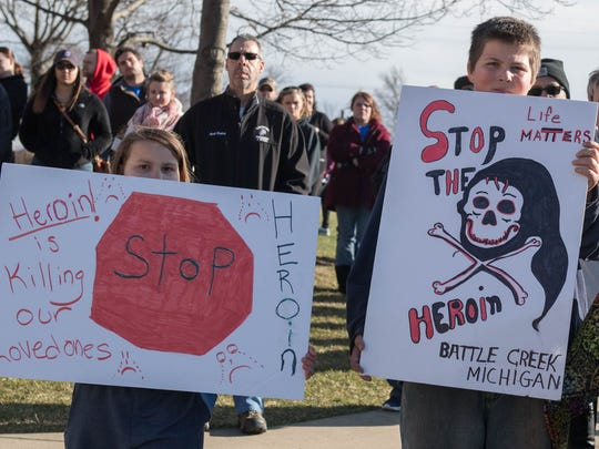 Enjoli Brown, left, and Anthony Runyan listen to speakers during the Rally Against Heroin held Tuesday.