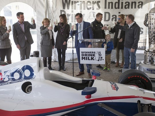 Representatives from the Indianapolis Motor Speedway, Rev, Kelsay Farms and Ed Carpenter share a toast and swig of milk at Kelsay Farms in Whiteland, Ind., Wednesday, March 22, 2017. The American Dairy Association is partnering with Rev, a Methodist Health Foundation event presented by Fifth Third Bank, inviting people to upload personal victory stories, tagged with #WinnersDrinkMilk. The American Dairy Association will donate 100 dollars per victory photo or video, up to 25,000 dollars, supporting trauma and emergency patients at IU Health Methodist Hospital.