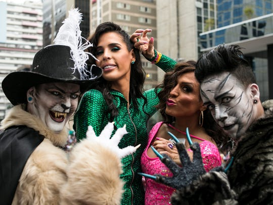 """Carmen Carrera, second from left, pictured in a scene from the documentary series """"Outpost."""""""