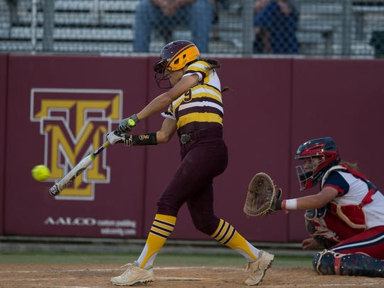 Tuloso-Midway's Jordyn Torre hits a single during the third inning of their game against Veterans Memorial at Tuloso-Midway High School on Tuesday, March 21, 2017.