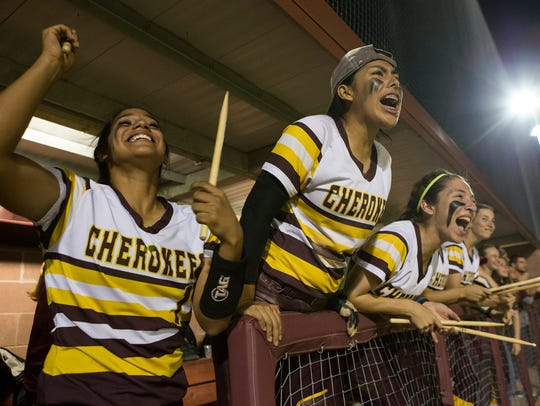 Tuloso-Midway players cheer from the dugout during