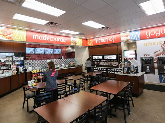 Seating for the in-store restaurant at a Ricker's convenience store in Columbus, Ind., Thursday, March 23, 2017. After the chain's lawyers realized the in-store restaurants qualified for cold beer sales, this Ricker's location and one in Sheridan, Ind., obtained the required licenses to serve cold beer to patrons for consumption in the restaurant or to-go. The Columbus location also sells liquor for consumption outside of the restaurant. To many in the liquor store industry, Ricker's use of this loophole seems like an attempt to cut into an area that has previously been domain of liquor stores, which are subject to additional regulations.