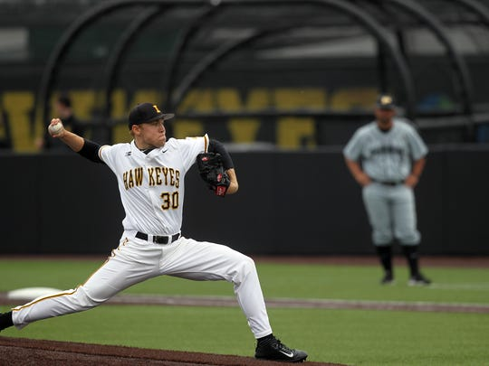 Iowa's Nick Gallagher delivers a pitch during the Hawkeyes'