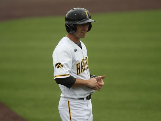Iowa's Mason McCoy waits at third base during the Hawkeyes'