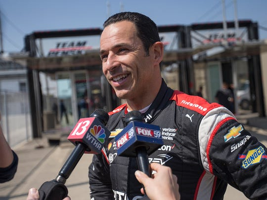 Helio Castroneves offers comments to media during a manufacturer testing session for Verizon IndyCar series drivers at Indianapolis Motor Speedway, Indianapolis, Friday, March 24, 2017.