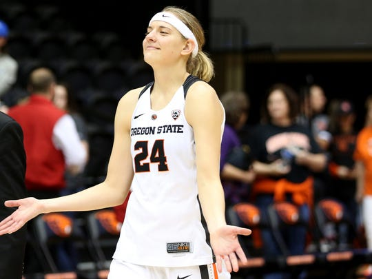 Oregon State's Sydney Wiese (24) smiles and walks off the court following the Creighton vs. Oregon State women's basketball game in the second round of the NCAA Division I Championship in Corvallis, Ore., on Sunday, March 19, 2017. Oregon State won the game 64-52 and will go on to play Florida State on March 25.