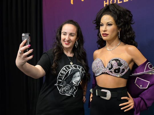 Rachel Casey of Boston MA, takes a selfie with the Madame Tussauds Hollywood wax Selena figure in the Art Museum of South Texas during Fiesta de le Flor on Friday, March 24, 2017.