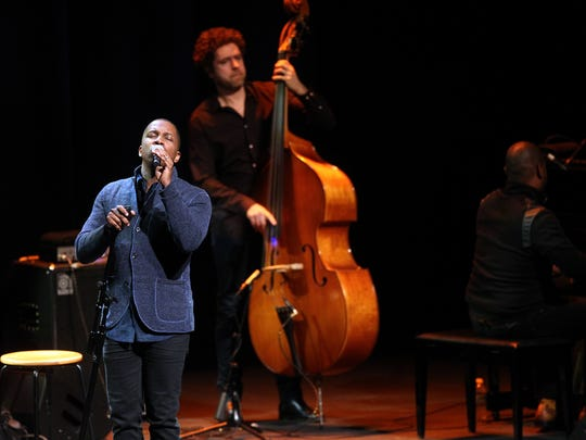 """Leslie Odom Jr. performs for guests at Hancher Auditorium on Monday, March 27, 2017. Odom starred as Aaron Burr in the Broadway production of """"Hamilton."""""""