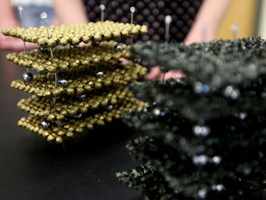 Atomic-level models of iron pyrite quantum dots, left,
