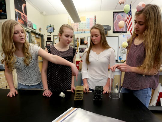 Alexa Montgomery, a sophomore, Sophia Hawley, a sophomore, Marcella Cross, a junior, and Emma Fagan, a junior, speak on their futuristic lithium-ion battery improvement technology that won the regional championships for the ExploraVision science competition. Photographed at West Salem High School on Thursday, March 23, 2017. The team now needs to create prototype, video and website explaining their technology for the national competition.