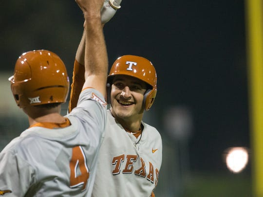 University of Texas's Michael Cantu high fives Tate Shaw after hitting a home run during the sixth inning for their game against the Islanders at Whataburger Field on Tuesday, March 28, 2017.