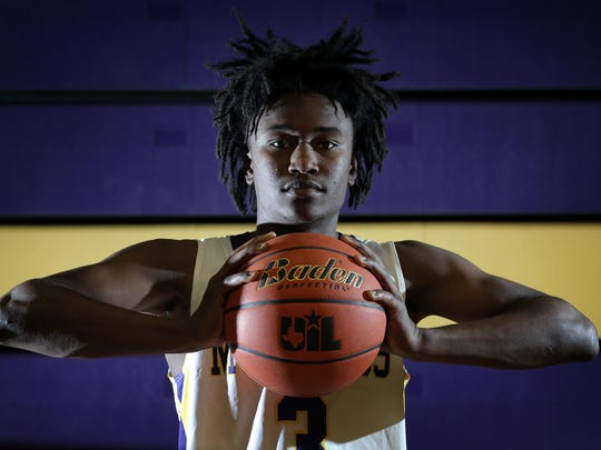 Burges junior Jawaun Newton is the El Paso Times' Boy's Basketball MVP for the 2016-2017 season.