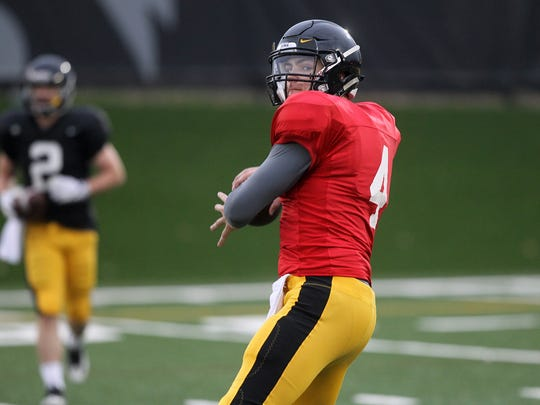 Iowa quarterback Nathan Stanley throws down field during practice on Wednesday, March 29, 2017.
