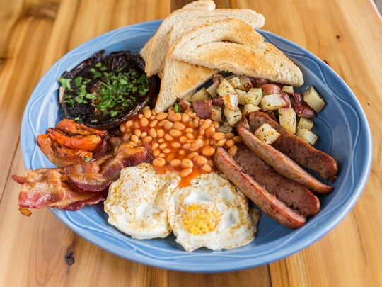 You can get a full English Breakfast at The Smith Cafe in Phoenix by ordering The Queen Mother: two cage-free eggs your way, Schreiner's sausage link, English-style baked beans, bacon, house hash, grilled mushroom, roasted tomato and toast.