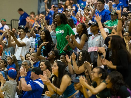 Fans cheer in the stand during the first half of the College Insider.com Tournament final at Dugan Wellness Center on Friday, March 31, 2017.