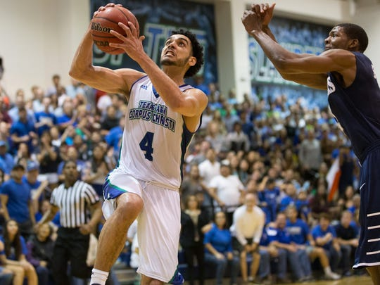 Texas A&M-Corpus Christi's Ehab Amin drives the ball to the basket during the second half of the College Insider.com Tournament final against Saint PeterÕs at Dugan Wellness Center on Friday, March 31, 2017.