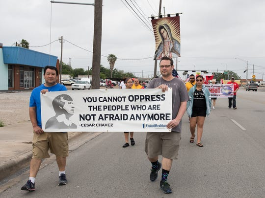 People march down Agnes Street during the18th annual Cesar Chavez Marcha on Saturday, April 1, 2017.