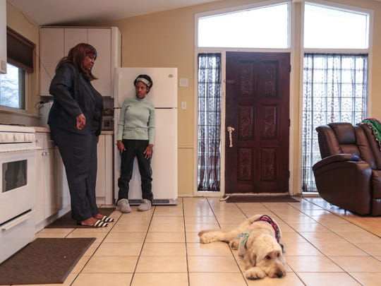 Kiara Williamson, 23, of Southfield stands in the kitchen