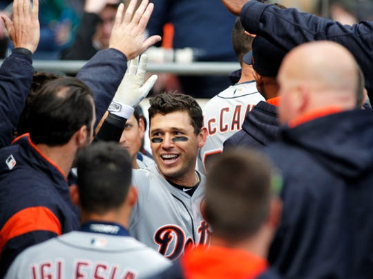 Tigers second baseman Ian Kinsler (3) celebrates with