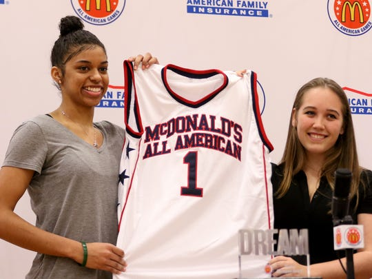 Evina Westbrook, left, accepts a jersey presented by Alyssa Pollard, a director of marketing for local McDonald's franchises, as Westbrook is named to the McDonald's All American basketball team at South Salem High School on Thursday, Jan. 19, 2017.