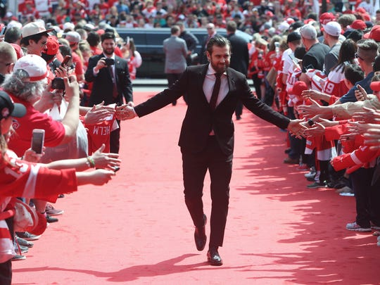 Red Wings' Henrik Zetterberg high fives fans along the red carpet upon arriving for the final hockey game at Joe Louis Arena against the Devils, April 9, 2017 in Detroit.