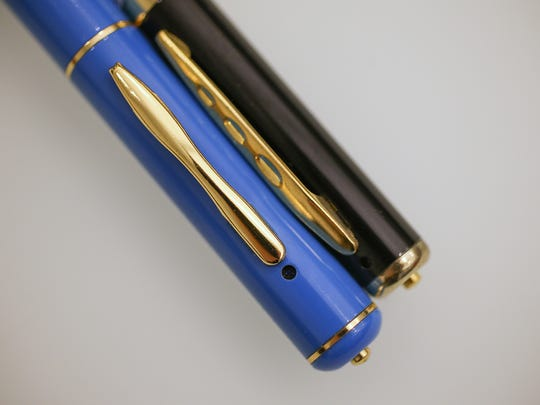 Pens with a spy cameras inside, photographed, Monday, April 10, 2017. The camera lens is the black dot seen at the top of the pen.