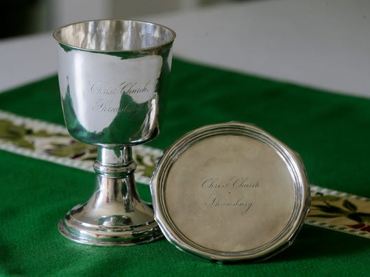 Detail a 300-plus year-old chalice and paten-holder