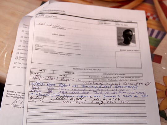 A view of Carlos Larios' Order of Supervision form from the Department of Homeland Security shown during an interview in his Long Branch home Thursday, March 30, 2017.  He and his wife with his wife Angelica Avila are Guatemalan nationals who illegally entered the U.S. and have lived here for more than a decade (Larios in since 2005, Avila since 2006).