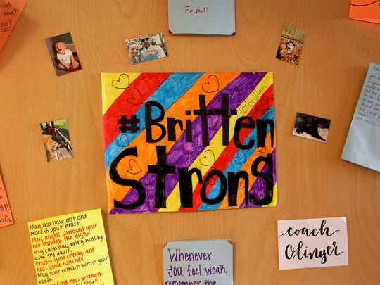 The door of Britten Olinger's hospital room at the Sheperd Medical Center in Atlanta is decorated with notes from family, friends and Black Mountain community members. Olinger is the head coach of Montreat College's men's and women's track and field teams.