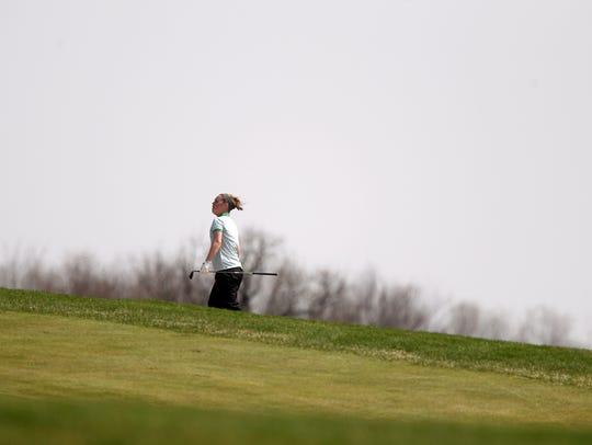 West High's Jordan Amelon walks up the fourth hole