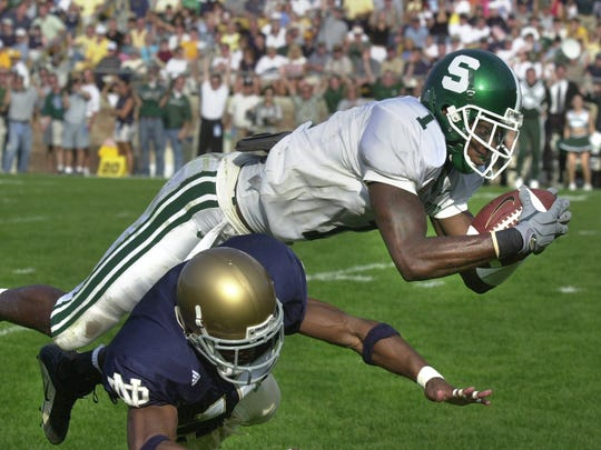 MSU wide receiver Charles Rogers leaps into the endzone over Notre Dame defender Clifford Jefferson to score the winning touchdown on a 47 yard pass play from quarterback Ryan Van Dyke in South Bend Saturday 9/ 22/01.