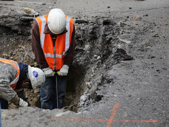 Crews work on finding the water main to replace the lead service line from the main to the valve box with a copper line for two houses on Welch Blvd. in Flint on Monday March 21, 2016 as part of Flint Mayor Karen Weaver's Fast Start program to remove Flint's lead-contaminated lines from 30 Flint homes.