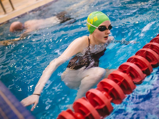 Livonia Community Swim Club swimmer Caitlin Jodway, 16, swims during practice at the Livonia Community Recreation Center in Livonia on Wednesday April 19, 2016.
