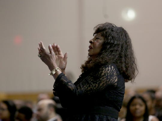 Motown legend Martha Reeves gives a standing ovation during a musical performance during the funeral of Motown songwriter and producer, Sylvia Moy, on Saturday, April 22, 2017, at the Greater Grace Temple in Detroit.