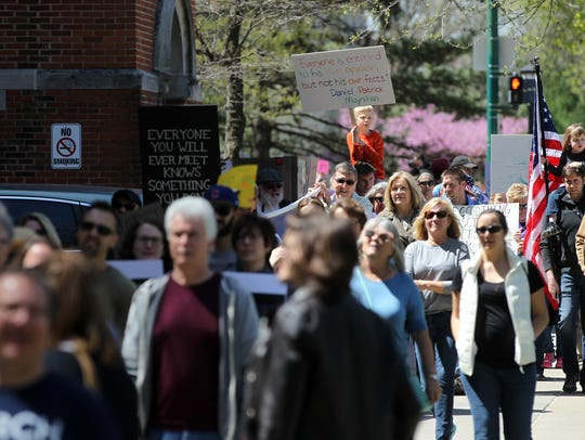 Community members celebrate Earth Day two years ago for the March for Science on Jefferson Street on Saturday, April 22, 2017.