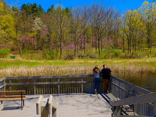 A couple feeds the fish in the pond at Fenner Nature Center Sunday, April 23, 2017.