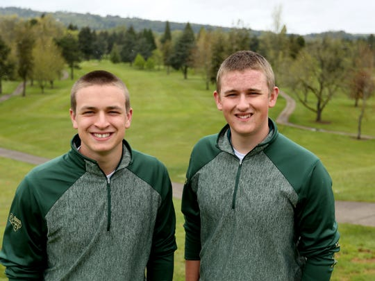 Regis High School golf team members Casey Humphreys, left, and Kyle Humphreys at the Illahe Hills Country Club in Salem on Monday, April 24, 2017. (A previous version of this photo caption had the names of Casey and Kyle Humphreys spelled incorrectly)