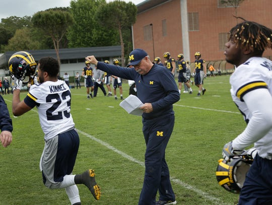 Michigan defensive coordinator Don Brown, center during