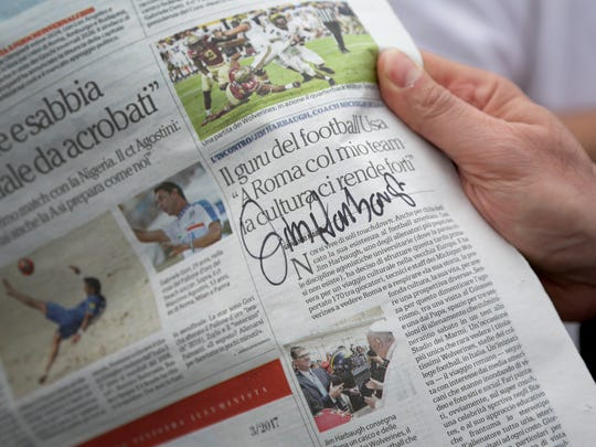 Michigan coach Jim Harbaugh signed an article about